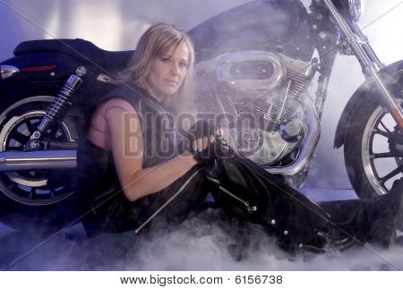 Woman Sitting By Motorcycle