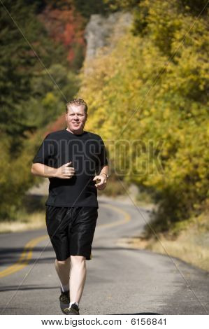 Man Running Fall Colors