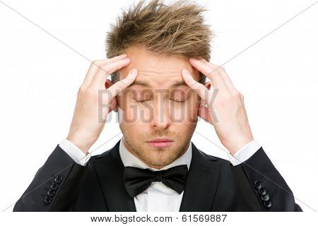 Portrait of manager with closed eyes putting hands on head, isolated on white. Concept of headache and high temperature