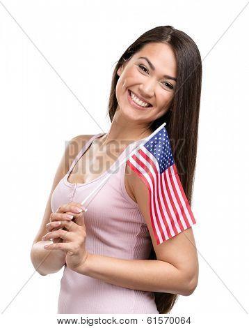 Half-length portrait of female handing American flag, isolated on white