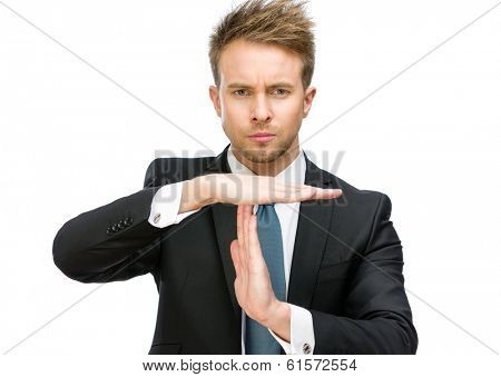 Half-length portrait of businessman time out gesturing, isolated on white