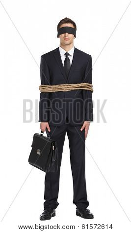 Full-length portrait of blind-folded businessman tied with the line, isolated on white. Concept of slavery and violence