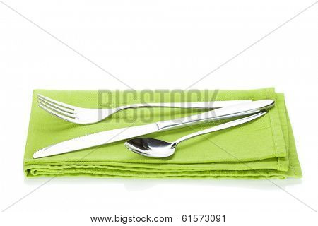Silverware or flatware set of fork, spoon and knife over kitchen towel. Isolated on white background