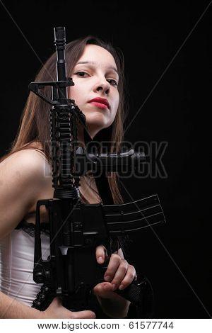 Girl Holding Rifle On Black Background