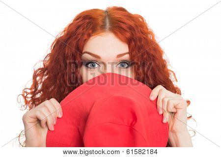 Beautiful red haired girl hid behind her hat.