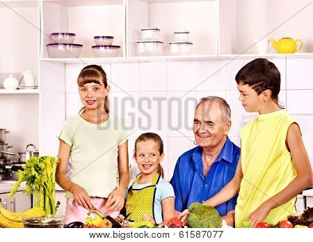Big family cooking at kitchen. Grandfather and children.
