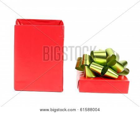 Opened red box with green bow.