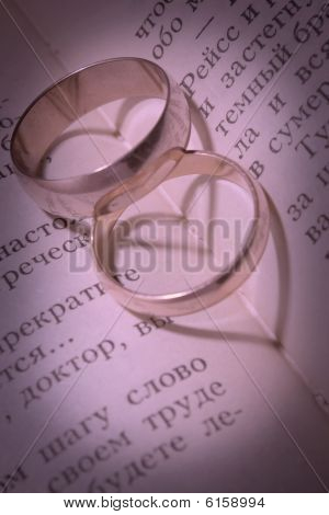 Gold Wedding Ring And Its Shade In The Form Of Heart