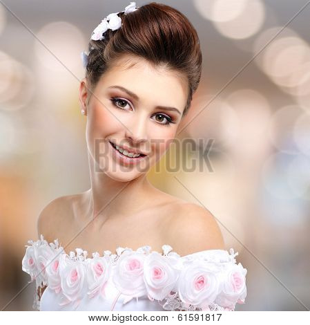 Portrait Of Beautiful Smiling  Bride In Wedding Dress