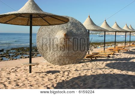 Sunshade. Beach on the bank of the red sea.