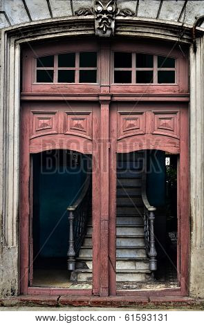 Ruined steps behind the door