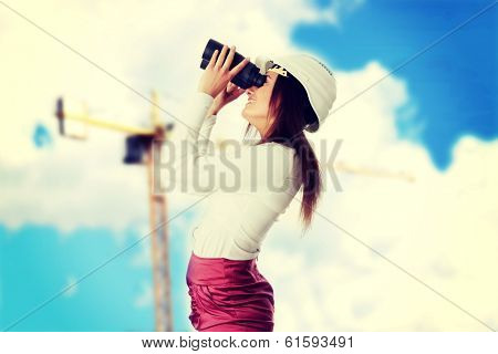 Business vision concept, enginer woman looking throught binoculars