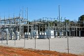 picture of electric station  - A High Voltage Electric Substation with Transformers - JPG