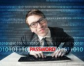 stock photo of geek  - Young geek hacker stealing password on futuristic background - JPG