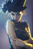 picture of top-hat  - Portrait of a attractive young female model with a top hat - JPG
