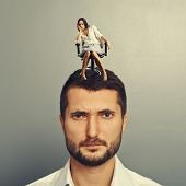 lazy woman sitting on the head of discontented man