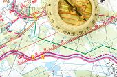 picture of longitude  - old touristic handheld compass on detailed territory map - JPG
