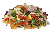 picture of rotten  - On a white table lies a heap of rotten food waste closeup concept - JPG