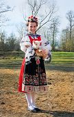 The Smiling Girl In Folk Costume With Little Lamb