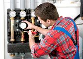 stock photo of boiler  - Technician servicing the gas boiler for hot water and heating