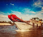 stock photo of pacific rim  - Vintage retro hipster style travel image of boat on Mekong river delta - JPG