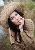 picture of nu  - Portrait of a girl in a straw hat against background of nature and old concrete wall - JPG
