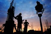 picture of labourer  - silhouette of construction worker on construction site  - JPG