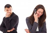 foto of cheating  - suspicious man looking at his woman talking on the phone smiling