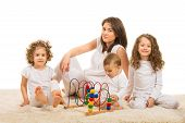 foto of three sisters  - Mother and three kids sitting on carpet in their home - JPG