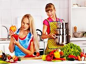 picture of pinafore  - Mother and daughter cooking food at kitchen - JPG