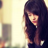 picture of depressed teen  - Young teen woman with depression - JPG