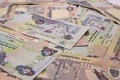 stock photo of dirham  - UAE 500 Dirham notes scattered in a pile - JPG