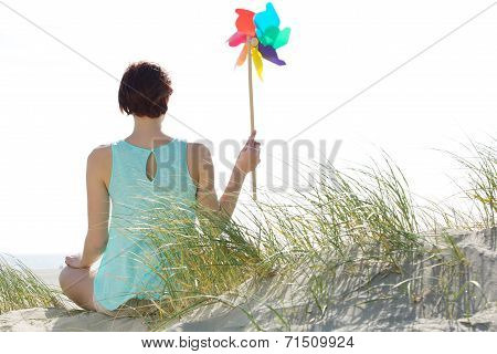 Woman Holding Colorful Pinwheel