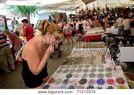 Woman Browsing Market