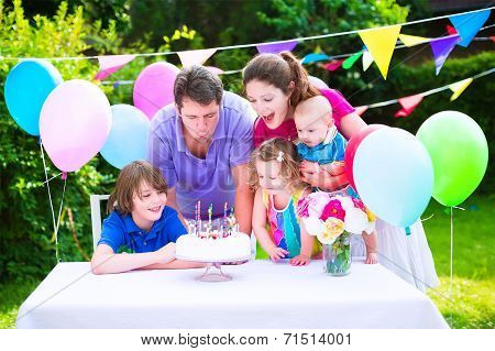 Happy Family At Birthday Party