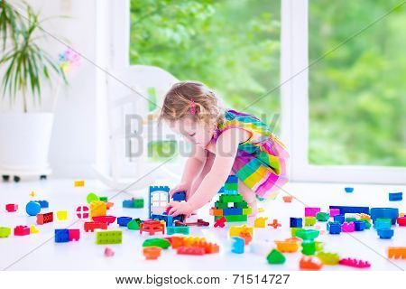 Little Girl Playing With Blocks