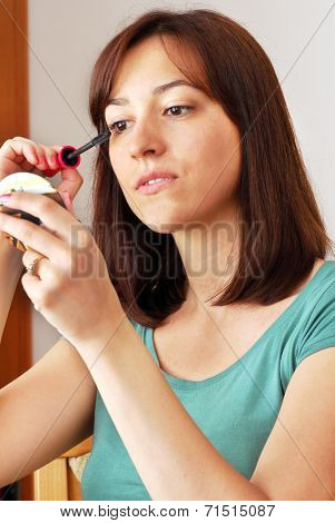 Young Woman Applying Makeup