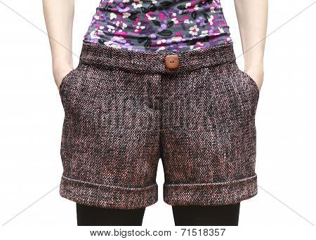 Women's shorts from wool tweed with hands in pockets isolated