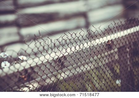 Iron Wire Fence On Gray Background