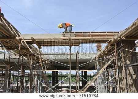 Construction Worker Installing Beam Formwork