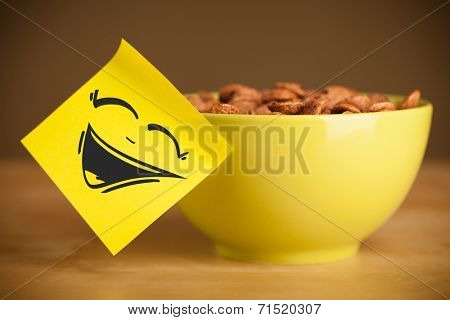 Drawn smiley face on a post-it note sticked on a cereal bowl