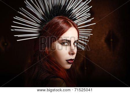 Closeup Portrait Of Cute Gothic Girl Wearing Spiked Headgear
