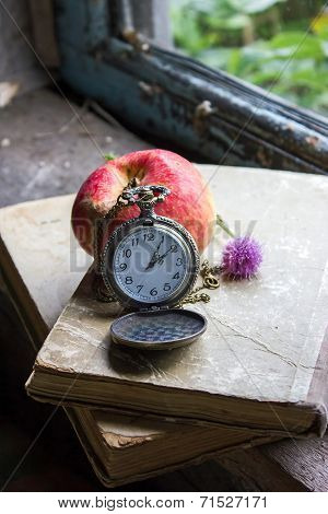 Clock, Books And Apple On The Old Window Sill