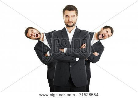 two screaming men behind confident young businessman. isolated on white background