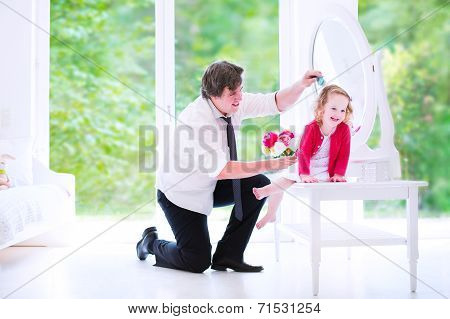 Father Brushing His Daughter Hair