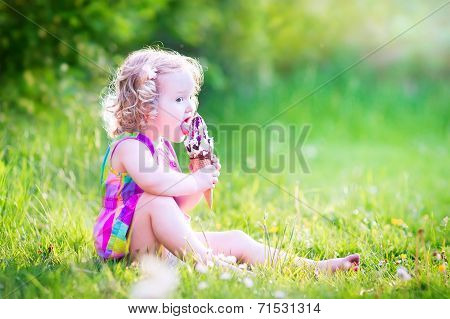 Funny Girl Eating Ice Cream In The Garden