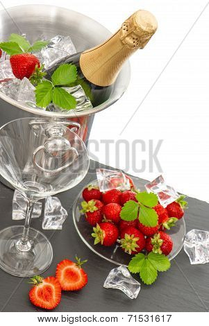 Festive Arrangement With Bottle Of Champagne And Strawberries