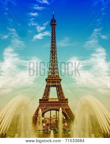 Eiffel Tower With Fountains Over Cloudy Blue Sky