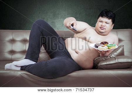 Man With Remote Tv And Donuts