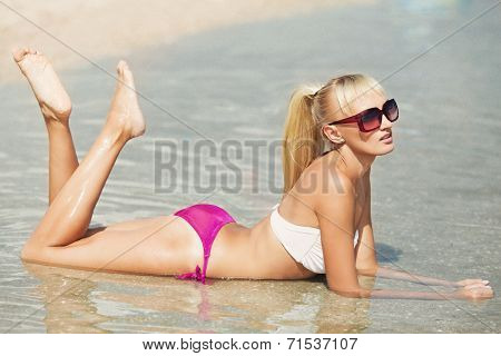 Sexy bikini girl posing at beach